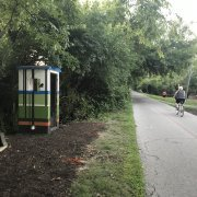 public art mural on train conductor phone booth Nora Indianapolis Indiana Nora Alliance Monon Trail